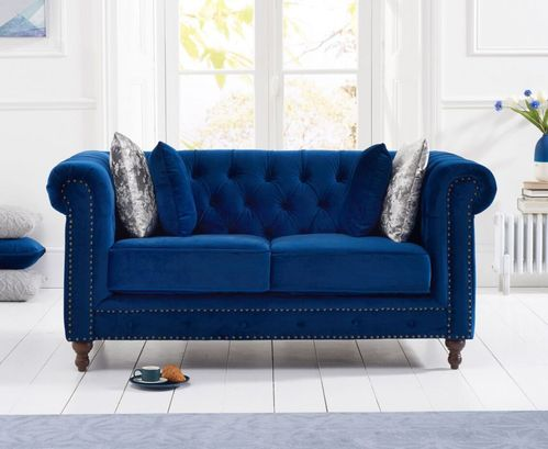 Stylish blue velvet 2 seater sofa with stud detail