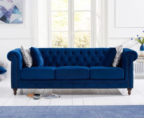 Stylish blue velvet 3 seater sofa with stud detail