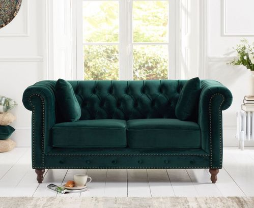 Stylish green velvet 2 seater sofa with stud detail