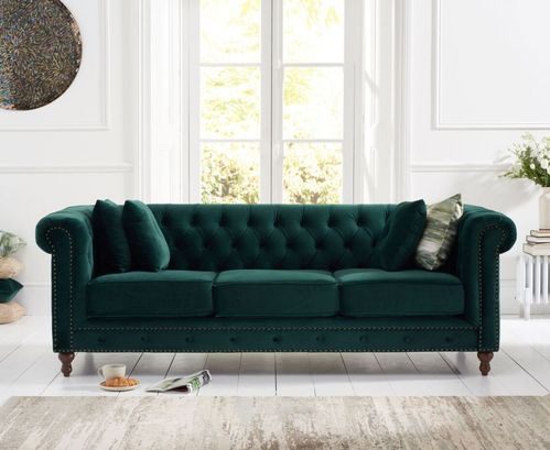 Stylish green velvet 3 seater sofa with stud detail