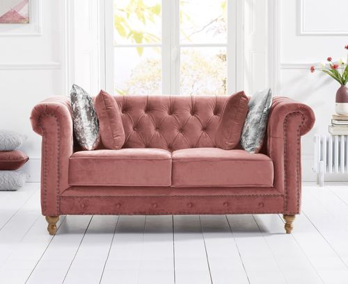 Stylish pink velvet 2 seater sofa with stud detail