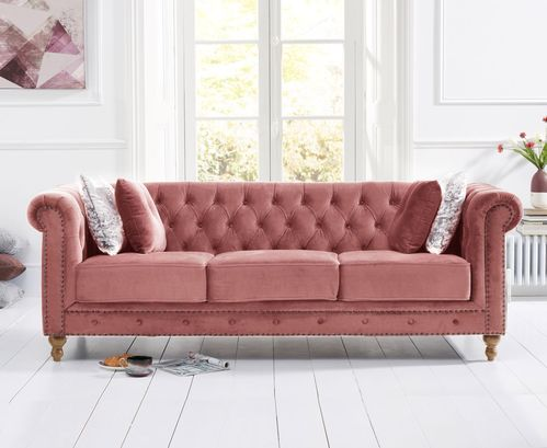 Stylish pink velvet 3 seater sofa with stud detail
