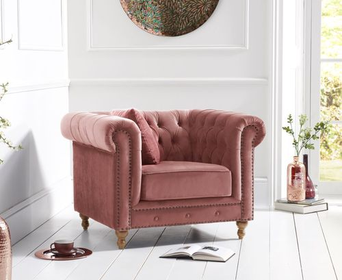 Stylish pink velvet armchair with stud detail