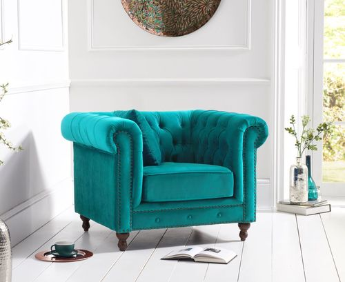 Stylish teal velvet armchair with stud detail