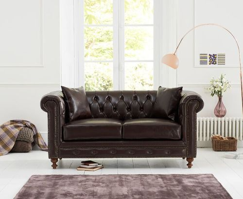 Brown leather 2 seater sofa with metal studding