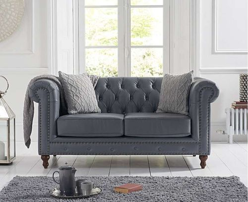 Grey leather 2 seater sofa with metal studding