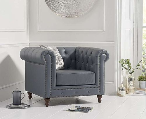 Grey leather armchair with metal studding