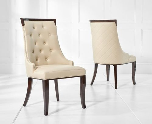 Regal cream faux leather dining chairs