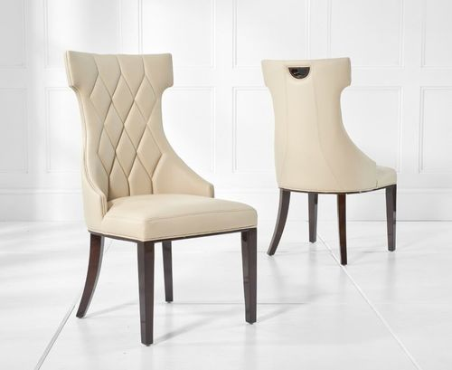 Cream faux leather dining chairs with diamond pattern