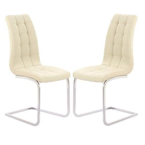 Cream faux leather dining chairs in pairs